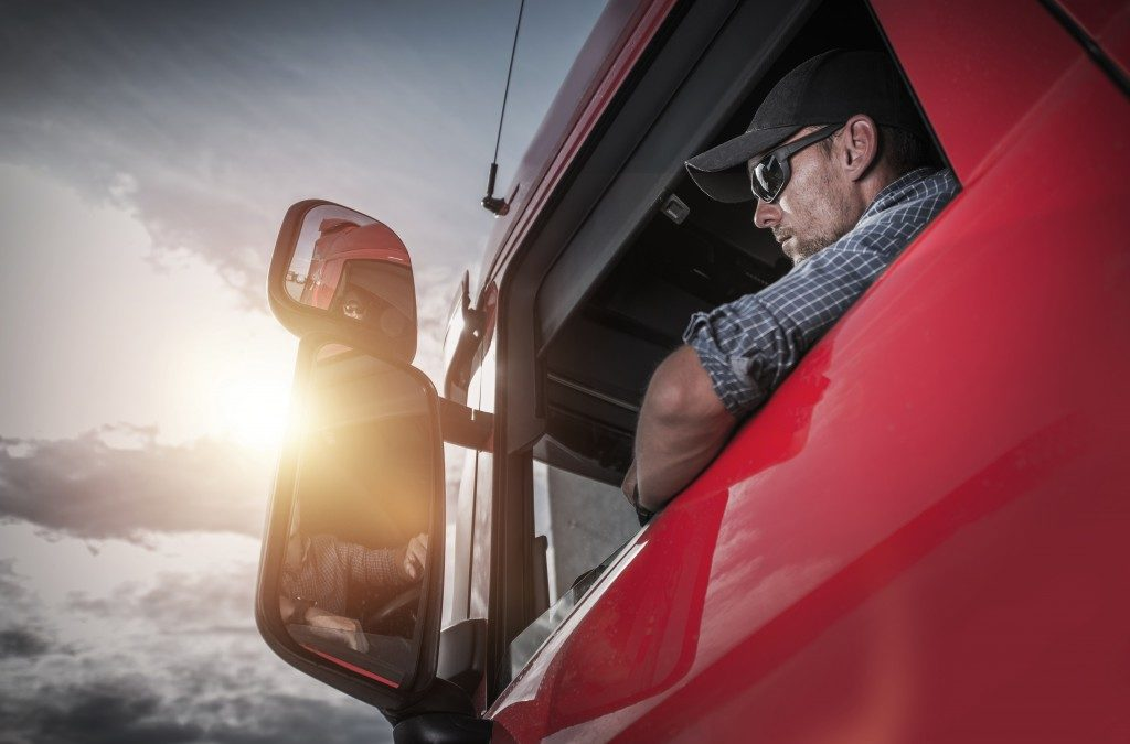 truck driver in a red truck