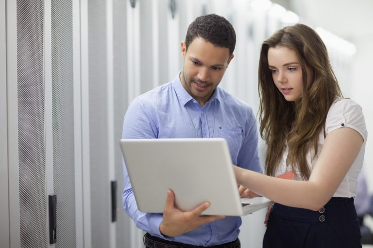 man and woman holding a laptop