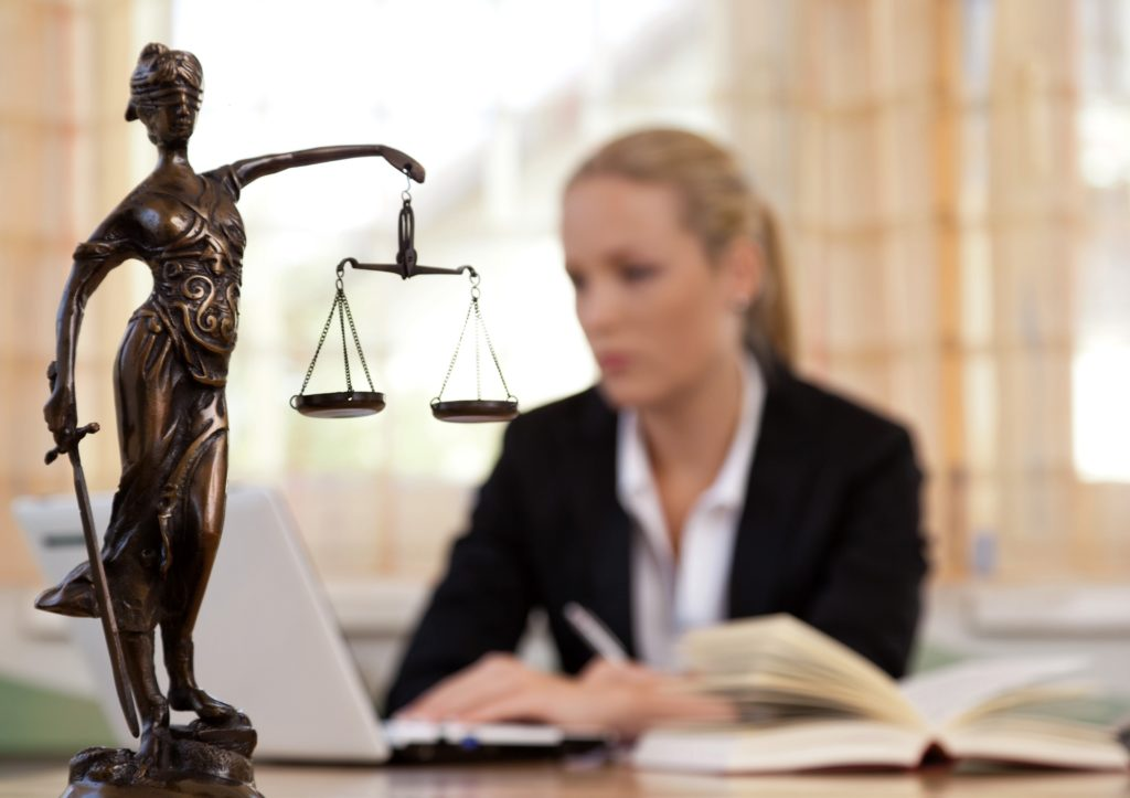 lady justice with lawyer on background
