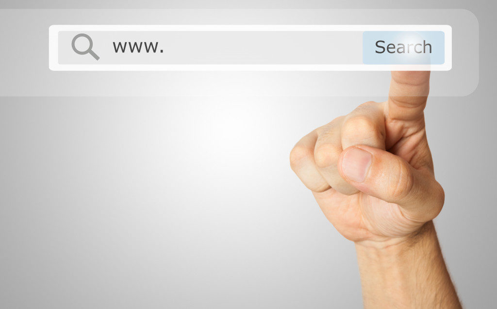 hand pointing to a virtual search bar