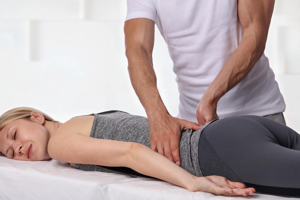 Massage therapist massaging a female