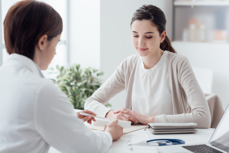 woman consulting a physician