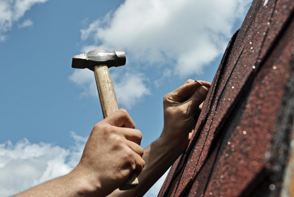 using hammer and nail