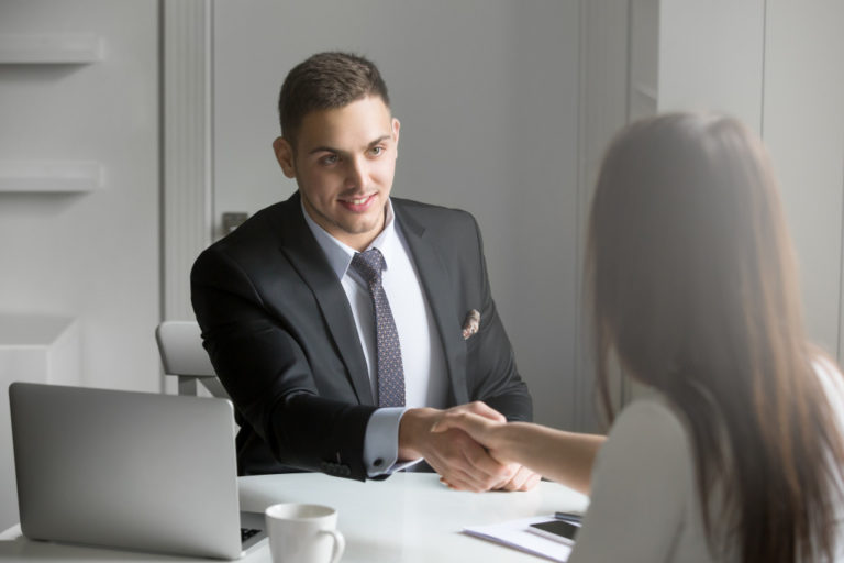 man shaking hands with client
