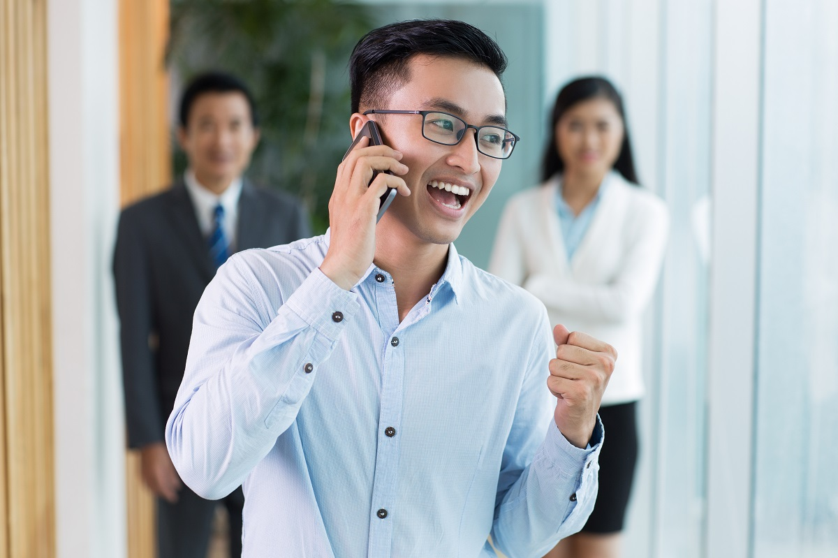 happy businessman talking on phone and shouting