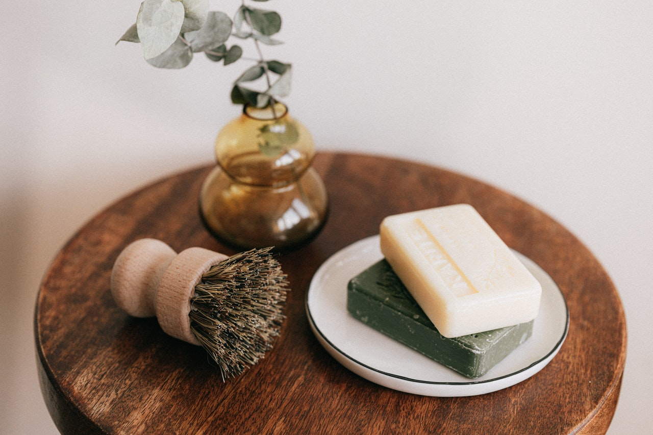 soap and plant on a small table