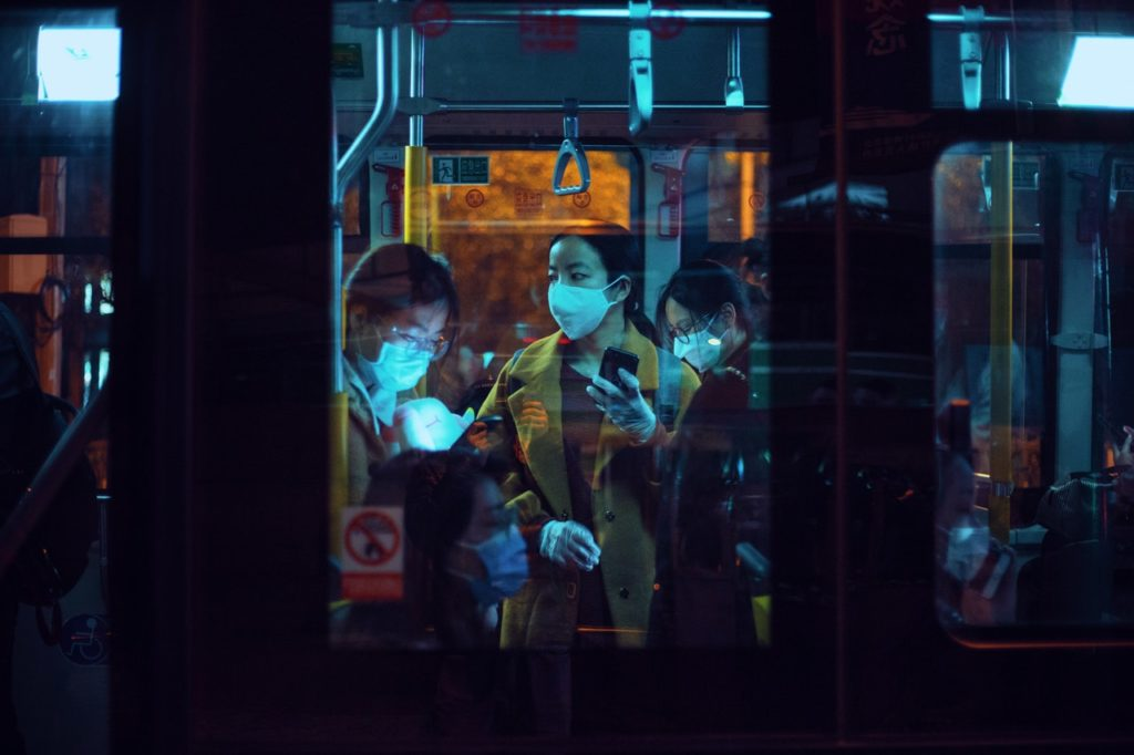 people on a train wearing masks