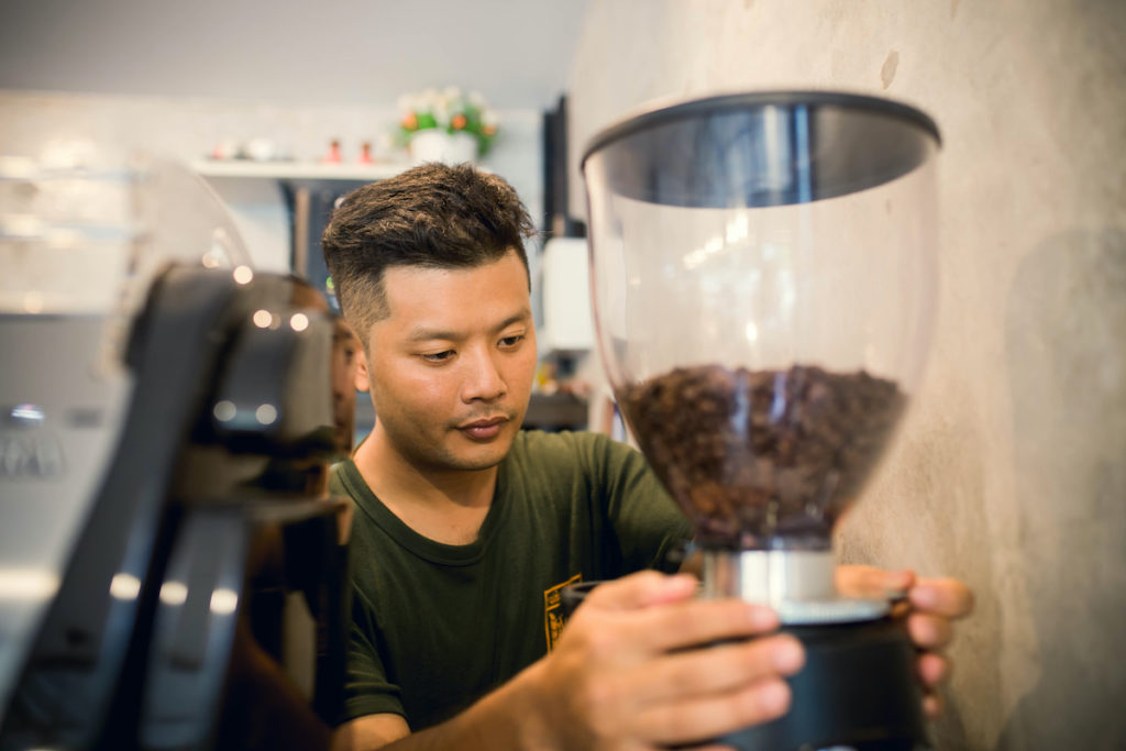 man preparing coffee beans