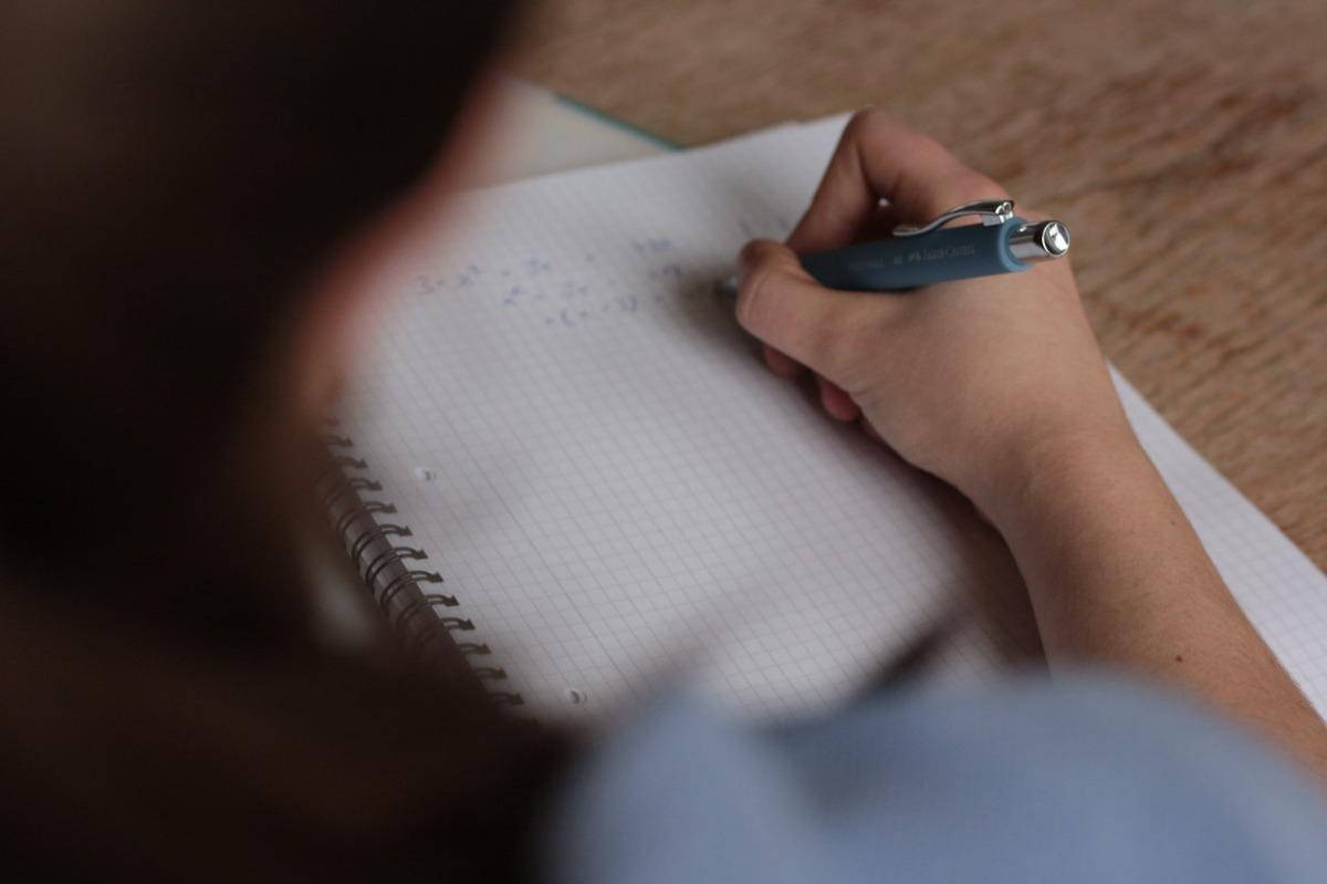 woman taking an exam