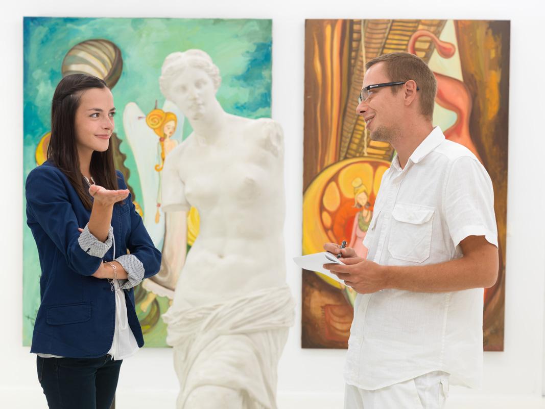 2 people in art gallery