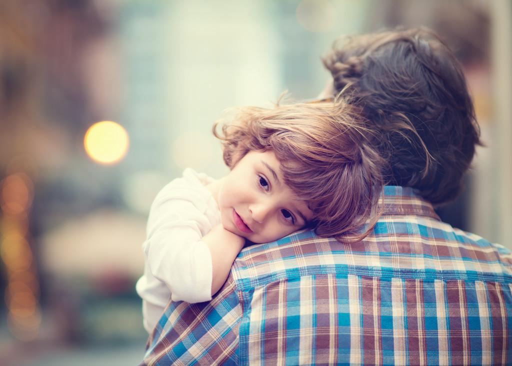 daughter on shoulder of dad