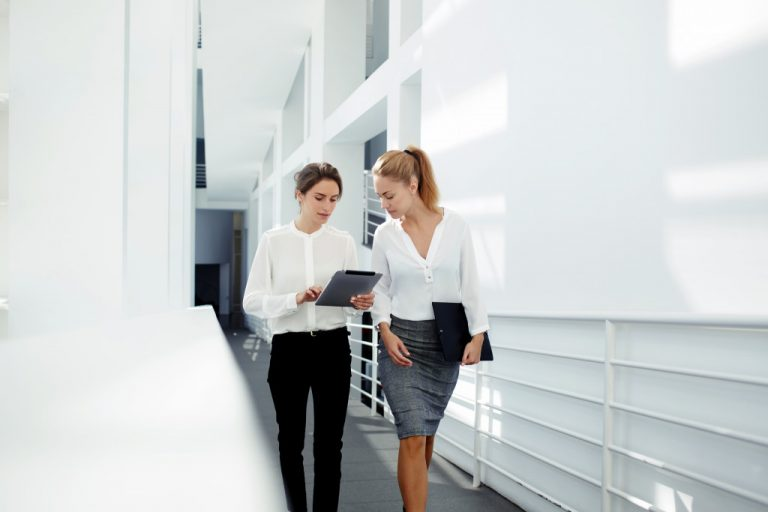 computer expert talking to colleague