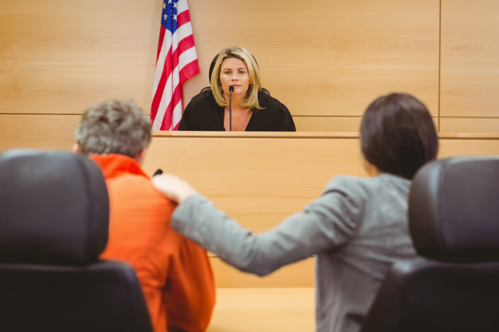 two people in front of a judge