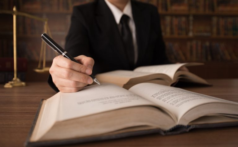 lawyer writing in books