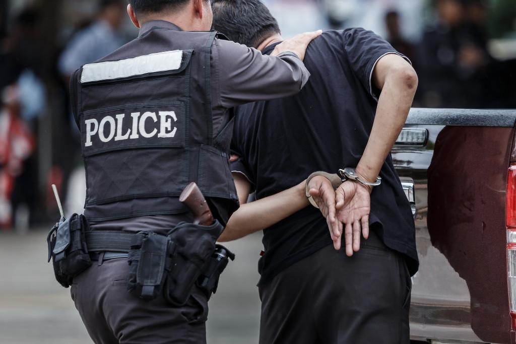 police arresting a suspecting
